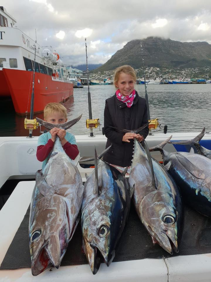 longfin tuna caught by young boy